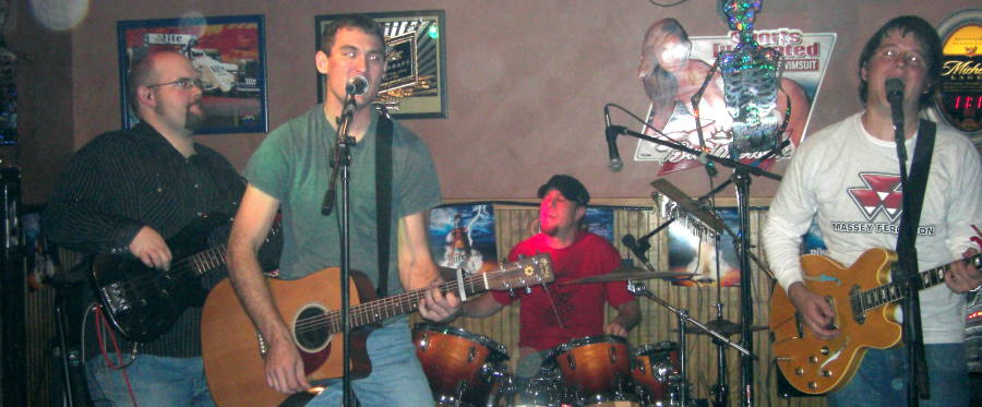 Aaron Traffas Band at the Plum Thicket in Kiowa on October 25, 2008 - left to right: Chris Goering, Lucas Maddy, Mason Powell, Aaron Traffas