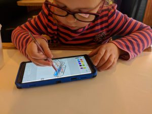 My niece enjoying the PENUP app
